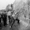 berlin-people-breaking-down-wall